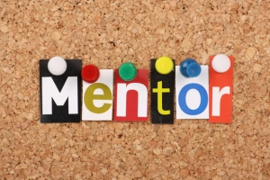 The word Mentor in magazine letters on a notice board